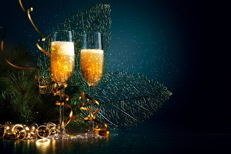 new years eve: Two champagne glasses ready to bring in the New Year