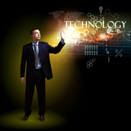 Businessman standing with modern technology symbols next to him photo