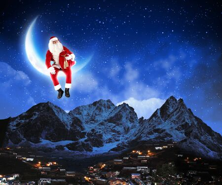 xmass: photo of santa claus sitting on the moon with a city and mountains below