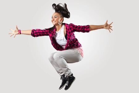 studio b: Young hiphop dancer making a move on white