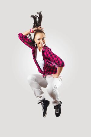 causal: Young hiphop dancer making a move on white
