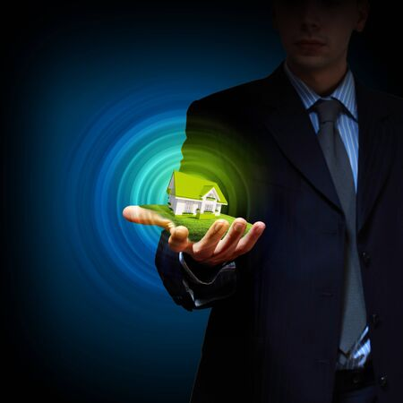 real estate house: Residential building and a businessman holding it in his hands Stock Photo