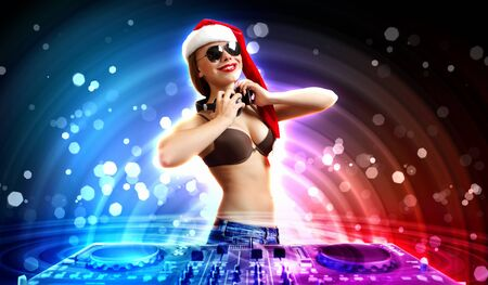 Young brunette woman in christmas wear with earphones photo