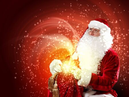 father Christmas carrying presents in his sack Stock Photo - 16764607