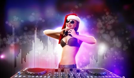 winter dance: Young brunette woman in christmas wear with earphones