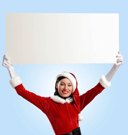 Portrait of a santa girl with a blank banner Stock Photo - 16764615