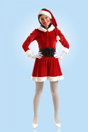 Portrait of beautiful young woman wearing santa claus clothes