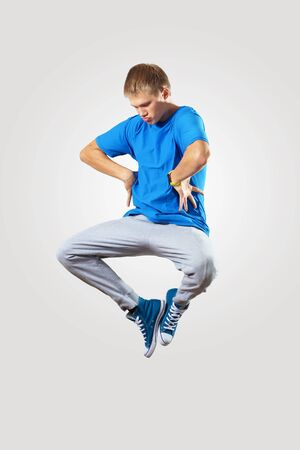 Young hiphop dancer making a move on white Stock Photo - 16830141
