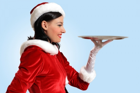 Excited Santa Girl presenting your product, lots of copy-space photo