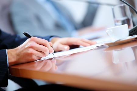 business deal: Image of a business work place with papers on the table