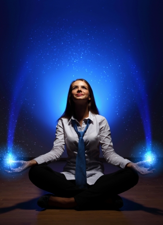 Young business woman sitting in asana lotus and meditating Stock Photo - 16865727