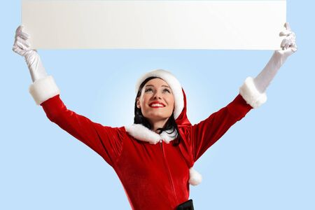 Portrait of a santa girl with a blank banner photo
