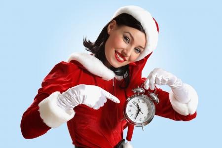excited girl with santa hat holding clock  illustration illustration
