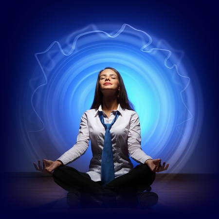 Young business woman sitting in asana lotus and meditating Stock Photo - 16866013