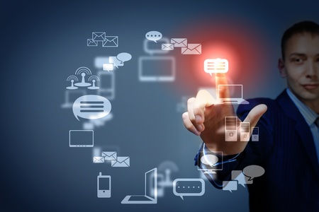 Business person pushing symbols on a touch screen interface Stock Photo - 16865998