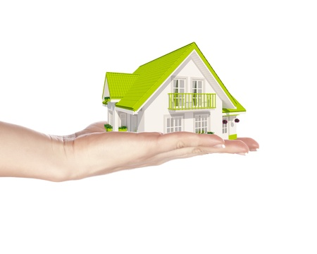 The house with colour roof in human hands Stock Photo - 16866596