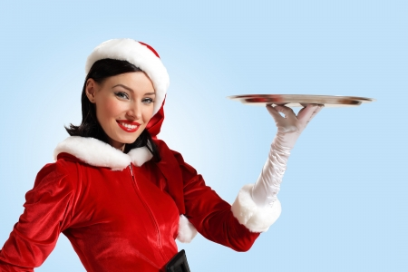Excited Santa Girl presenting your product, lots of copy-space Stock Photo - 16865974