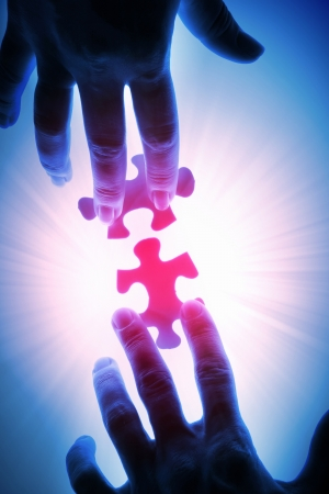 puzzle piece coming down into its place Stock Photo - 16866728
