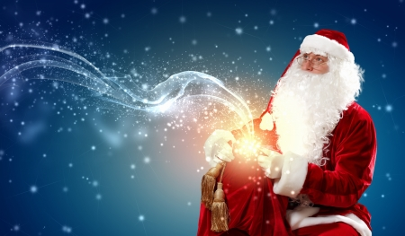 father Christmas carrying presents in his sack Stock Photo - 16865966