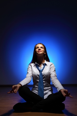 Young business woman sitting in asana lotus and meditating Stock Photo - 16866301