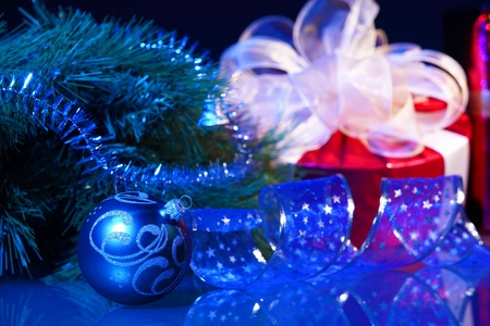 Blue Christmas collage  Ball and ribbon on a blue background  photo
