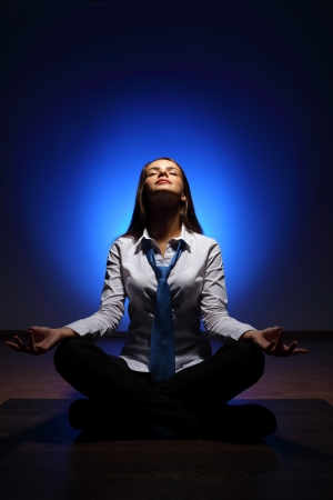 Young business woman sitting in asana lotus and meditating Stock Photo - 16866251