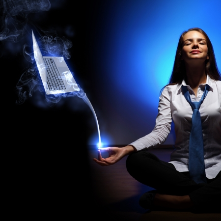 Young business woman sitting in asana lotus and meditating Stock Photo - 16866319