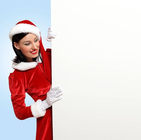 Portrait of a santa girl with a blank banner Stock Photo - 16866317