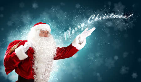 Christmas theme with Santa holding magical lights in hands Stock Photo - 16866134