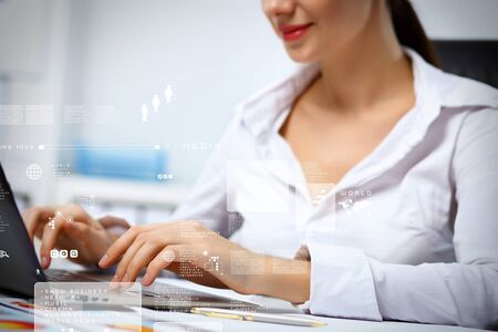 Business person working on computer against technology background Stock Photo - 16866239