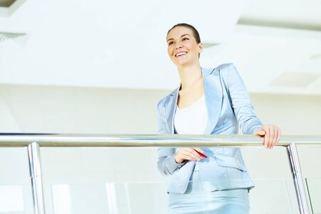 Portrait of happy smiling young businesswoman in office Stock Photo - 16866146