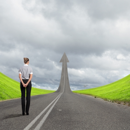 Concept of the road to success with a businesswoman standing on the road Stock Photo - 16866415