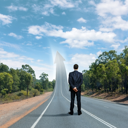 Concept of the road to success with a businessman standing on the road Stock Photo - 16866421