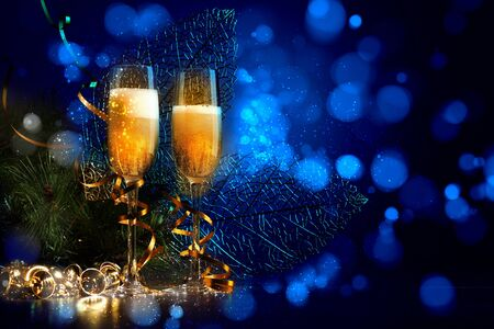 Two champagne glasses ready to bring in the New Year photo