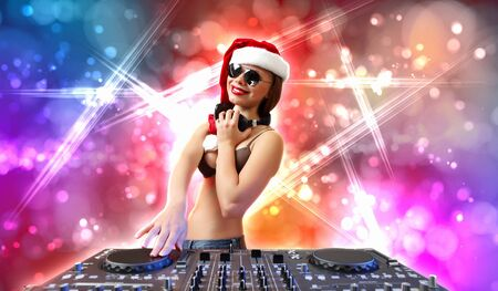 Young brunette woman in christmas wear with earphones Stock Photo - 16866184