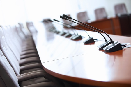 meeting room: before a conference, the microphones in front of empty chairs