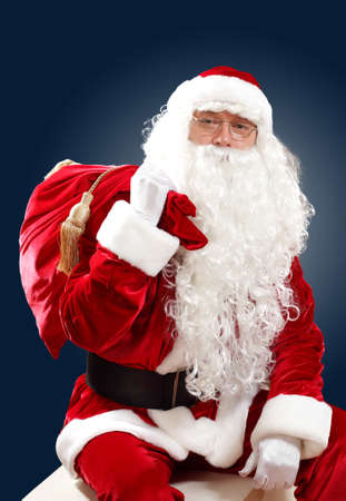 Santa Claus with his magic gift red bag full of presents Stock Photo - 16884625