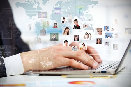 virtual world: Young business person working with a notebook Stock Photo