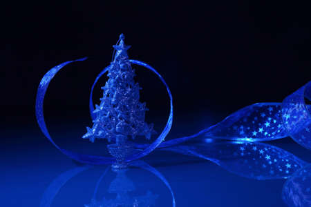 Blue Christmas collage  Decorations and ribbons on a blue background photo