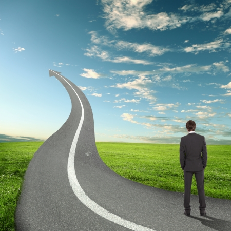 Concept of the road to success with a businessman standing on the road Stock Photo - 16884634