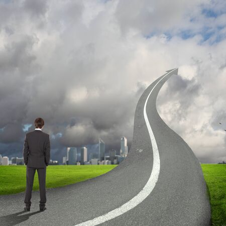 Concept of the road to success with a businessman standing on the road photo