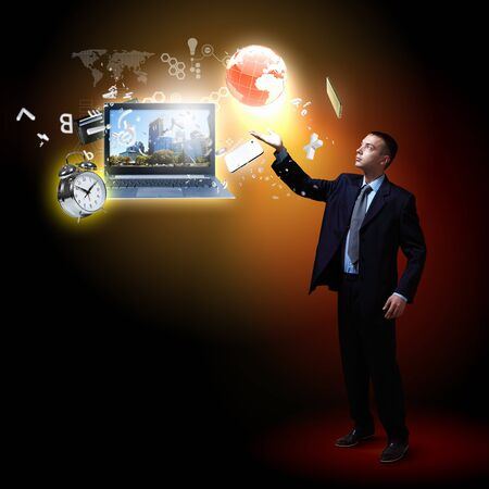 Businessman standing with modern technology symbols next to him Stock Photo - 16884667