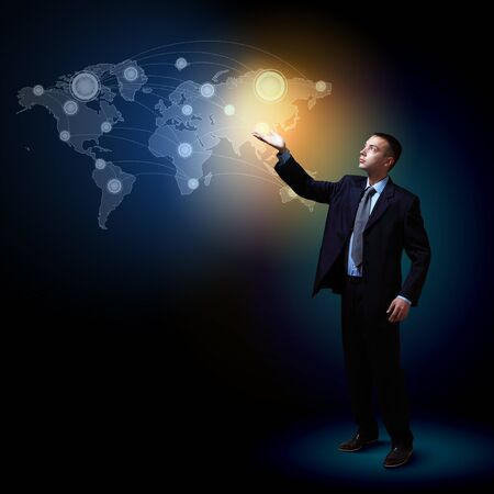Businessman standing with modern technology symbols next to him Stock Photo - 16895678