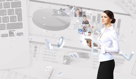 Young business person working with a notebook Stock Photo - 16895556