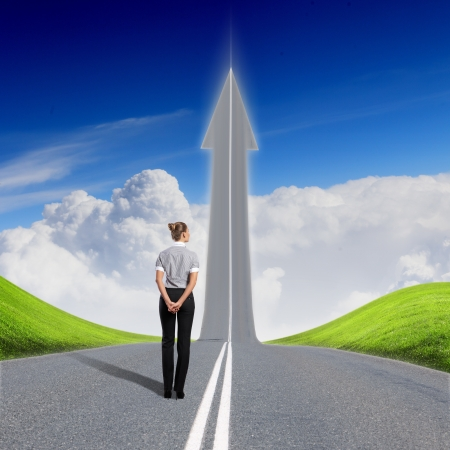 Concept of the road to success with a businesswoman standing on the road