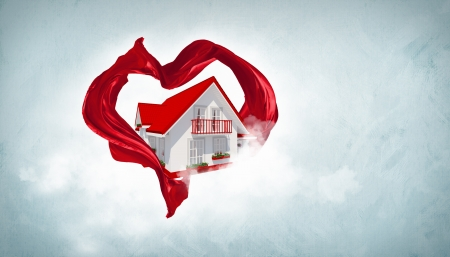 House withing a red heart symbol from fabrique photo
