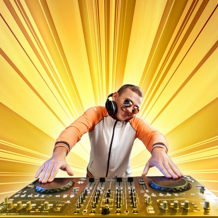 dj mixer: DJ with a mixer equipment to control sound and play music Stock Photo