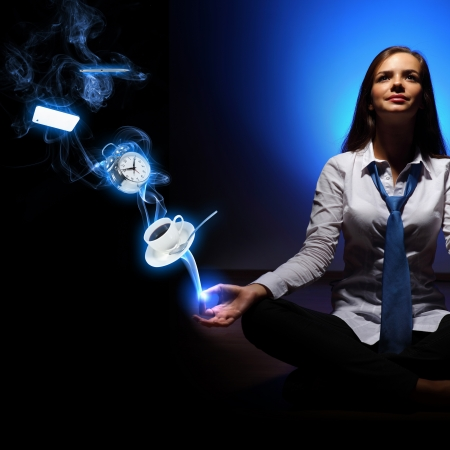 Young businesswoman sitting against blue background with clock interface Stock Photo - 16895722