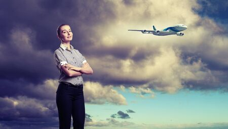 Busines person and plane on the background against cloudy sky photo