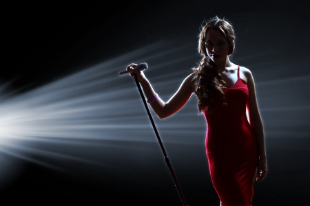 Female singer on the stage holding a microphone Stock Photo - 16906052